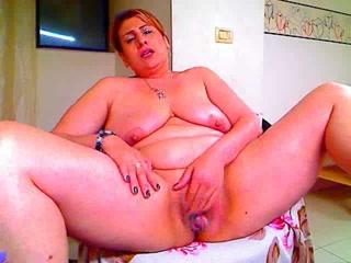 BBW MILF fingers her pussy